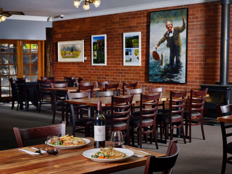 A portrait of Australian chef Tony Bilson hangs in the main dining room