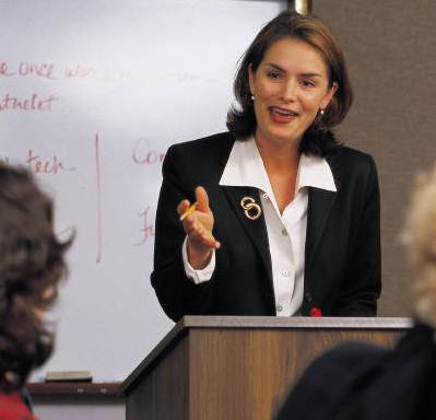 Business woman speaking to one person in the group