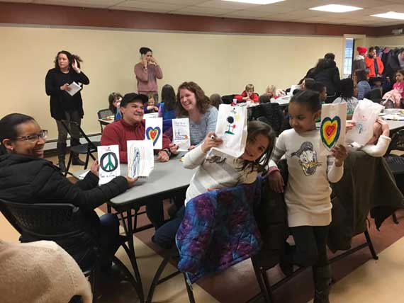 Community decorates luminary bags prior to MLK Jr. Day