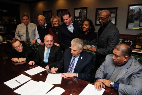County officials and construction trades unions sign labor agreement