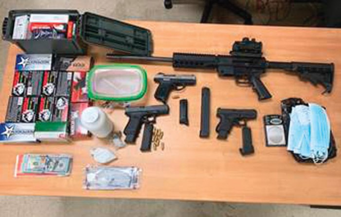 Cache of drugs and weapons seized by Irvington police