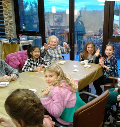 DOI residents, Girl Scouts make bracelets together