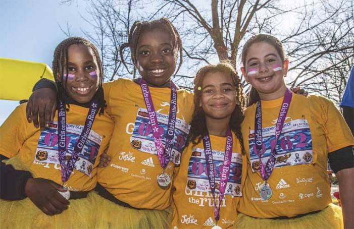 Girls on the Run participants cross the finish line at Turkey Trot 5K