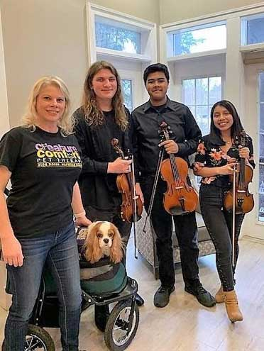 Orchestra students entertain residents at Care One on Super Bowl Sunday