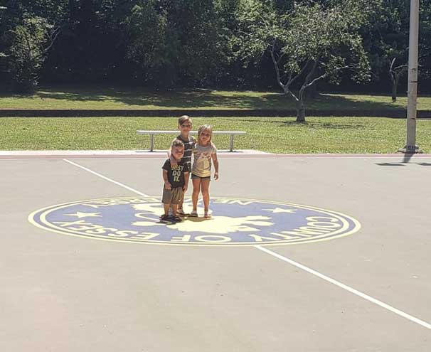 Nutley youngsters clean up trash at basketball court