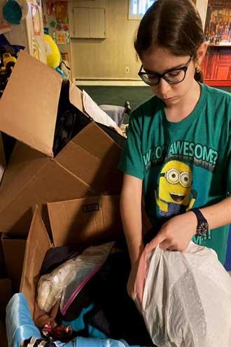 West Orange student Nava Brickman donates to those in need