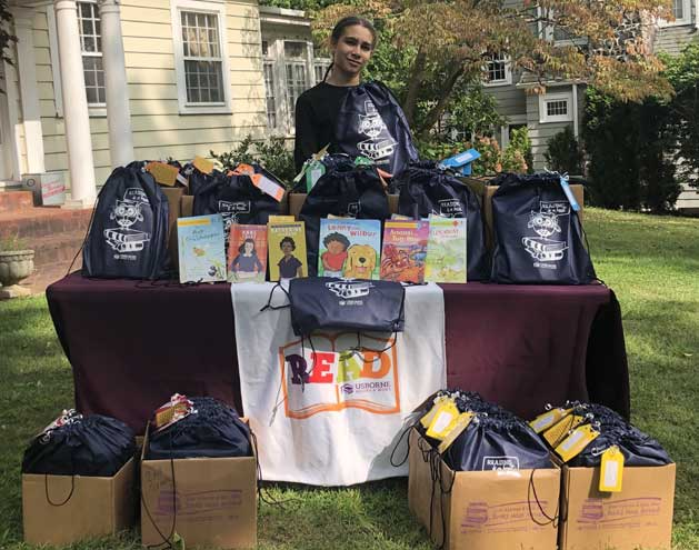Student donates 60 bags of books