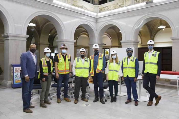 Construction management firm donates furniture to Newark library