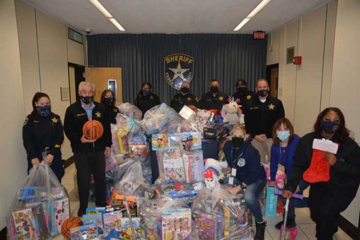 Sheriff's officers deliver delight through toys this holiday season