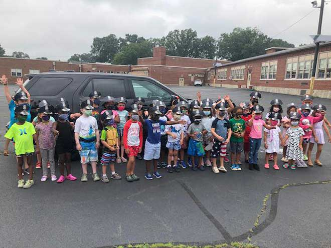 Bloomfield officers discuss stranger danger, bicycle safety with campers