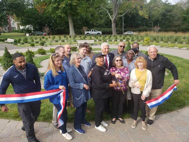 County cuts the ribbon on gardens in Monte Irvin Orange Park