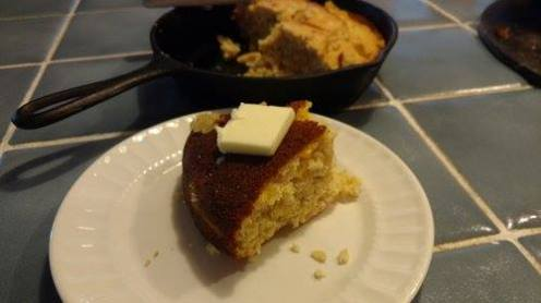Cornbread cooked in a cast-iron skillet