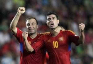 Armenia's Gevorg Ghazaryan celebrates with his team mate Artur Edigaryan after scoring against Czech Republic during their 2014 World Cup qualifying soccer match in Prague