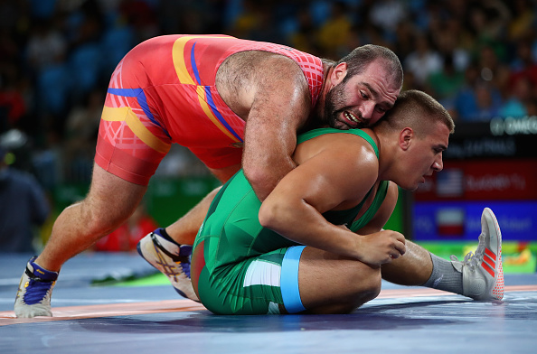 RIO DE JANEIRO, BRAZIL - AUGUST 20: Daniel Ligeti of Hungary in action with Levan Berianidze of Armenia in the mens freestyle 125kg on Day 15 of the Rio 2016 Olympic Games at Carioca Arena 2 on August 20, 2016 in Rio de Janeiro, Brazil. (Photo by Clive Brunskill/Getty Images)