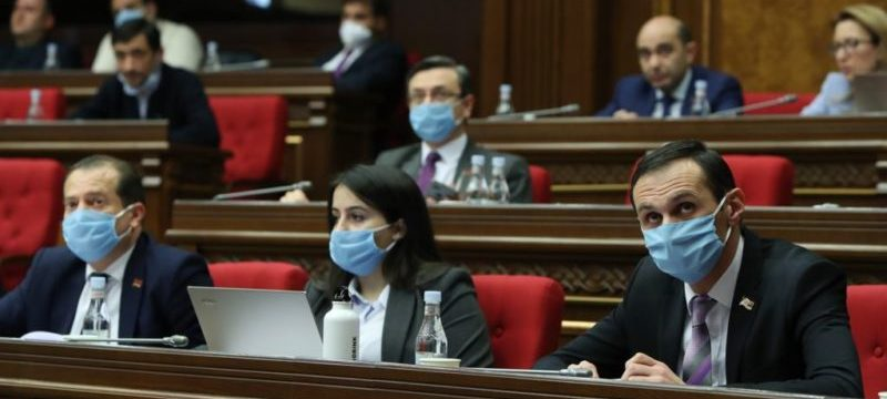 Deputies-wear-face-masks-during-a-parliament-session-in-Yerevan-March-30-2020-e1585865980611