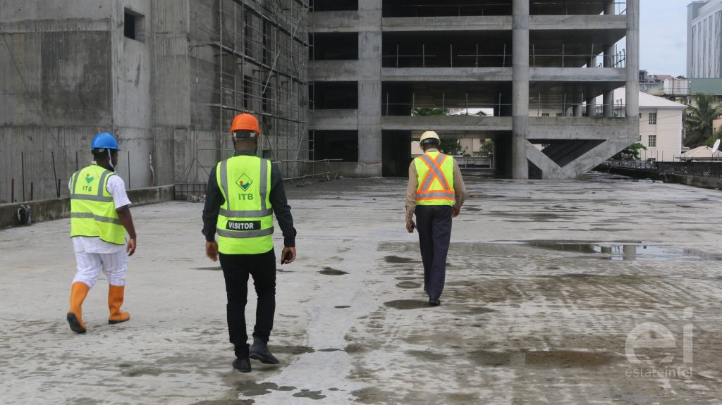 three estate intel officials walking into the Trinity Towers construction site at Chief Yesuf Abiodun Oniru Way, Lagos