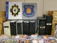 Desmantelan dos centros de falsificación de CD y DVD en la Costa Daurada