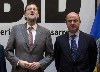 Mariano Rajoy y Luis de Guindos, el pasado julio, en un acto en Madrid.