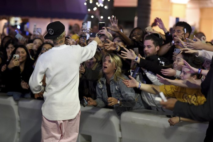 Justin Bieber greets fans upon his arrival at the 'premiere' of 'Seasons'.