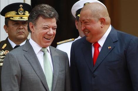 Santos y Chávez en el Palacio de Miraflores.   AP