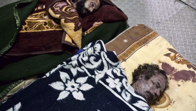 Gadafi y su hijo Mutasim. | EPA