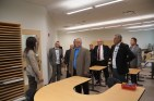Deputy Premier Don Morgan, Warren Kaeding MLA, Dwayne Reeve Parkland College President and members of the GSSD board getting tour of a classroom.