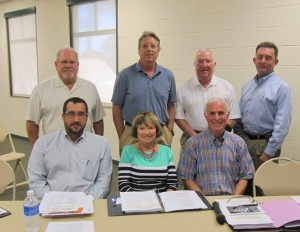 The Village of Estero Planning and Zoning Board, seated (left to right) Ryan Binkowski, Marlene Naratil, Chairman Roger Strelow.  Standing (left to right) David Crawford, Ned Dewhirst, Scotty Wood, Jeff Maas.