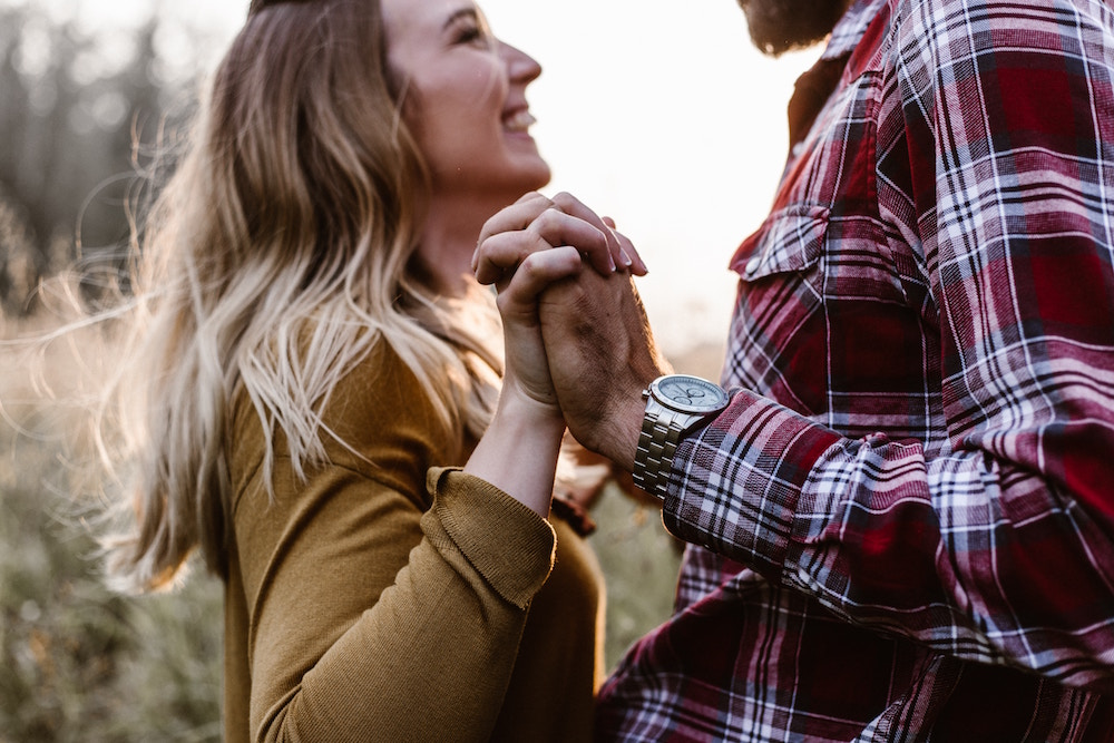 couple holding hands | 13 Questions to Ask for a Marriage That Lasts