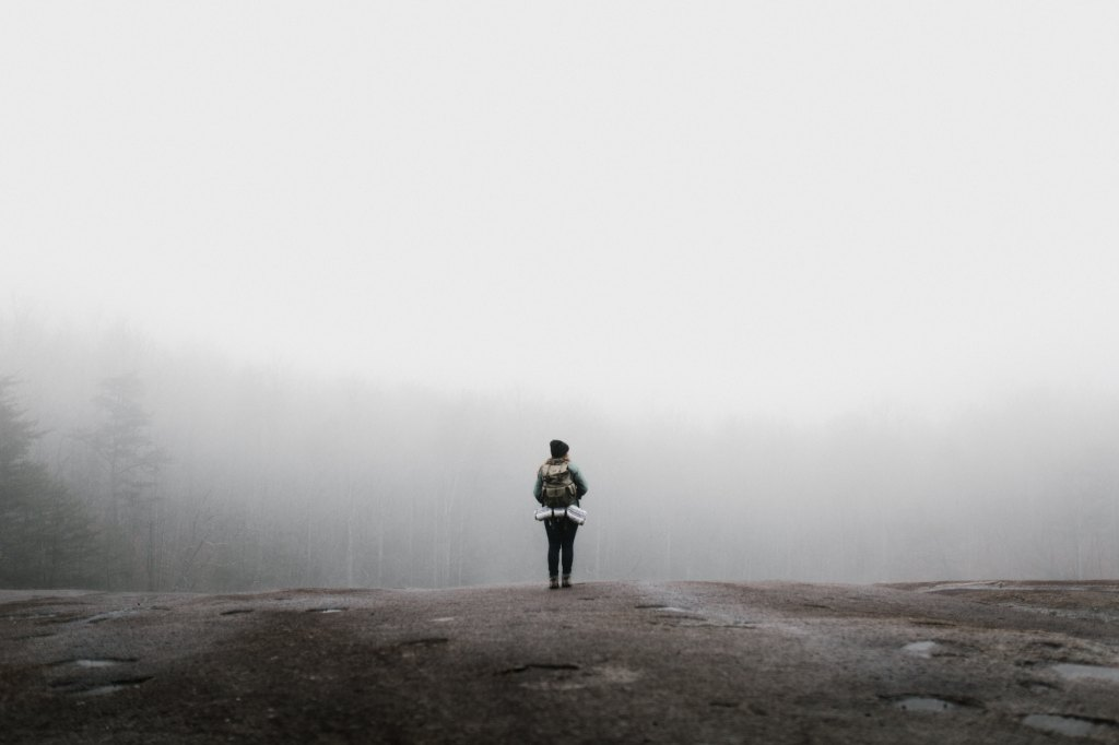Woman standing alone on a rock | What to Do When the Tears Keep Falling: 5 Ways to Cope as a Mom