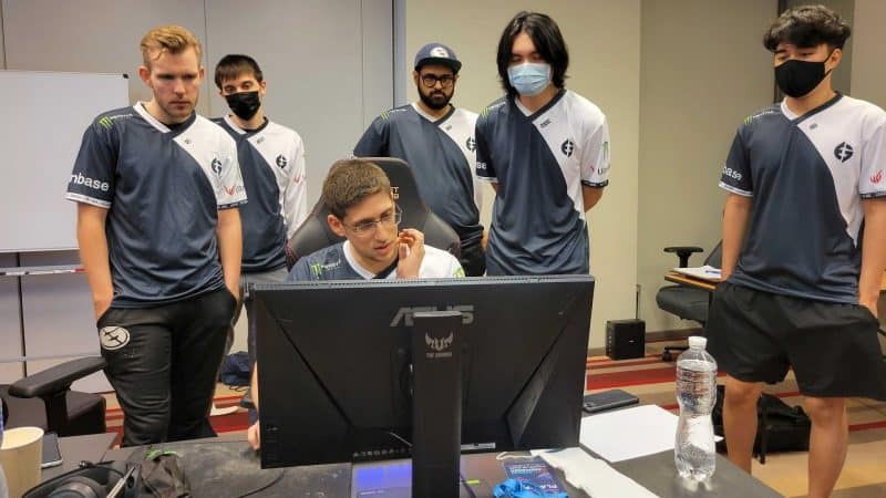 The roster for Evil Geniuses watch the monitor as the draft is decided ahead of a live game at the Dota 2 WePlay AniMajor