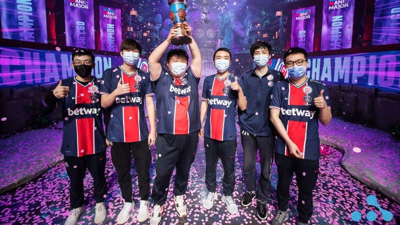 The roster for LGD hold aloft their trophy together on stage after winning the WePlay Esports AniMajor in Kyiv
