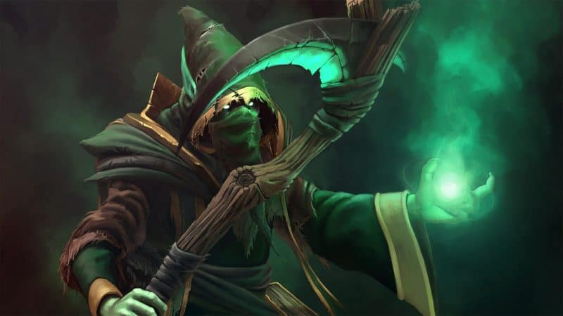 The Dota 2 hero, Necrophos, summons eldritch green flames into his hands as he watches from behind his hooded robe