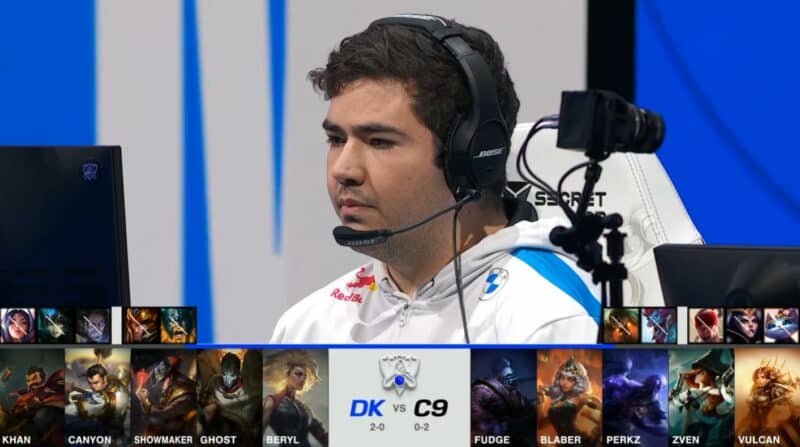 A screenshot from the 2021 World Championship Main Event Group Stage broadcast, showing the champion drafts between DAMWON KIA and Cloud9 with a shot of C9 top laner Fudge above.