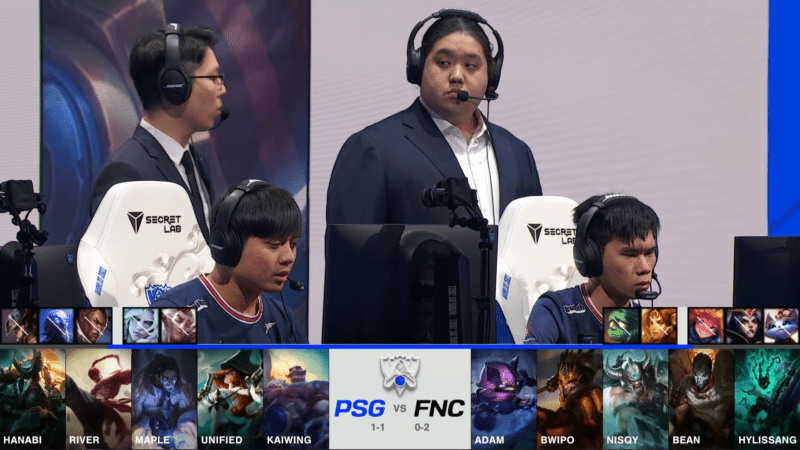 A screenshot from the 2021 World Championship Main Event Group Stage broadcast, showing the champion drafts between PSG.Talon and Fnatic with a shot of PSG players and coaches on stage above.