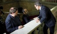 Artur Mas junto a Antonio Baños y Oriol Junqueras. (Reuters)