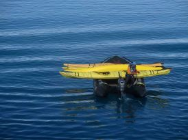 zodiac drivers help pick up kayaks to speed up return to ship