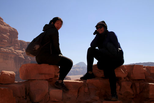 sitting on wall of Lawrence of Arabia site
