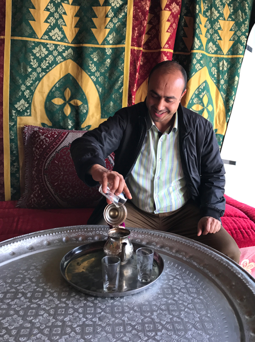 pouring tea in marrakesh medina