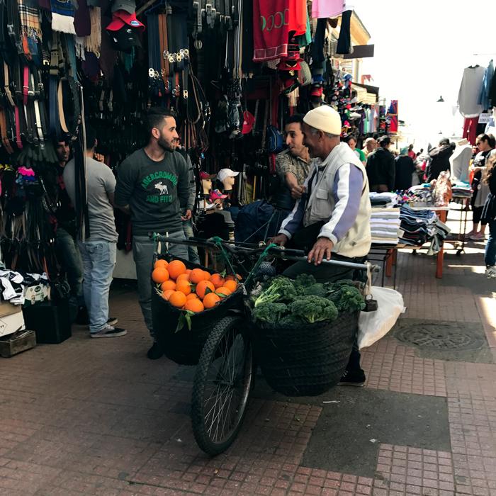 bicyclist selling oranges in rabat medina