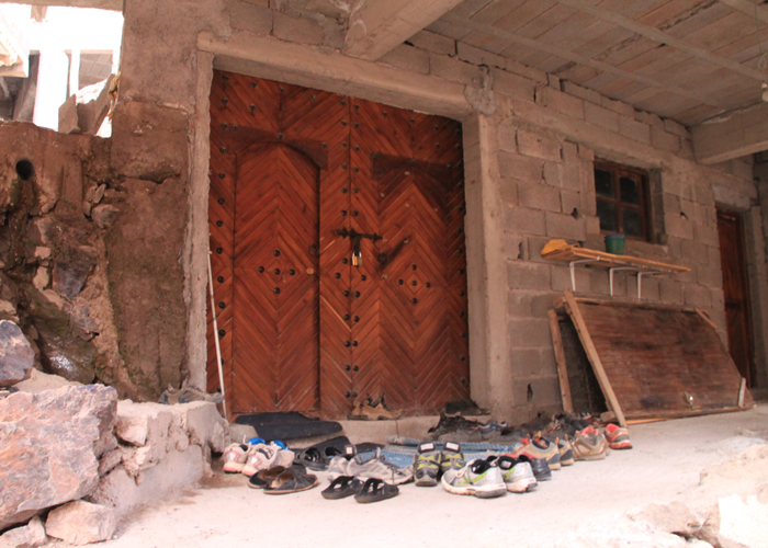 shoes outside mosque in the high atlas mountains
