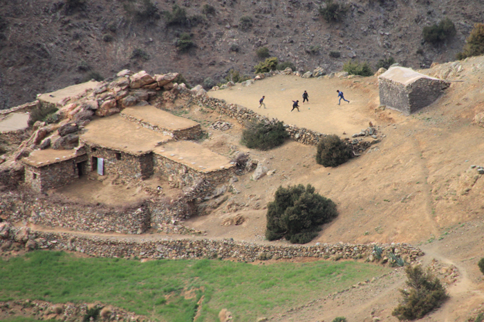 boys playing soccer in berber village on tizi mzik trail