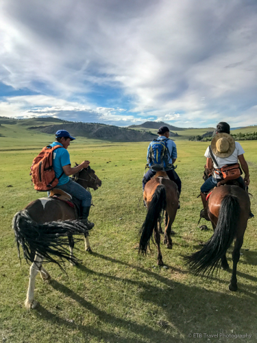 riding horses on the mongolian steppe