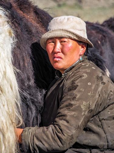 ankha milking a yak