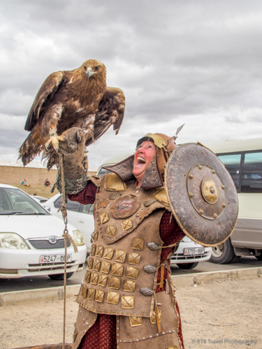 ingrid holding a golden eagle in mongolia