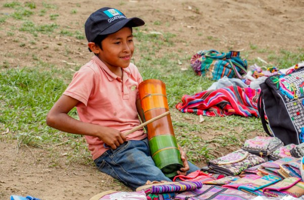 child selling wares on the hill