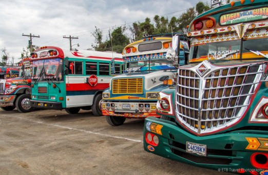 chicken buses behind the local market