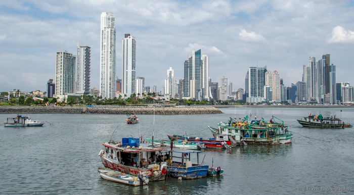 fishing harbor with panama city skyline