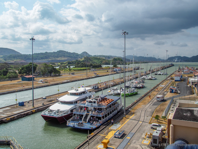 small boats in the miraflores locks in the Panama Canal