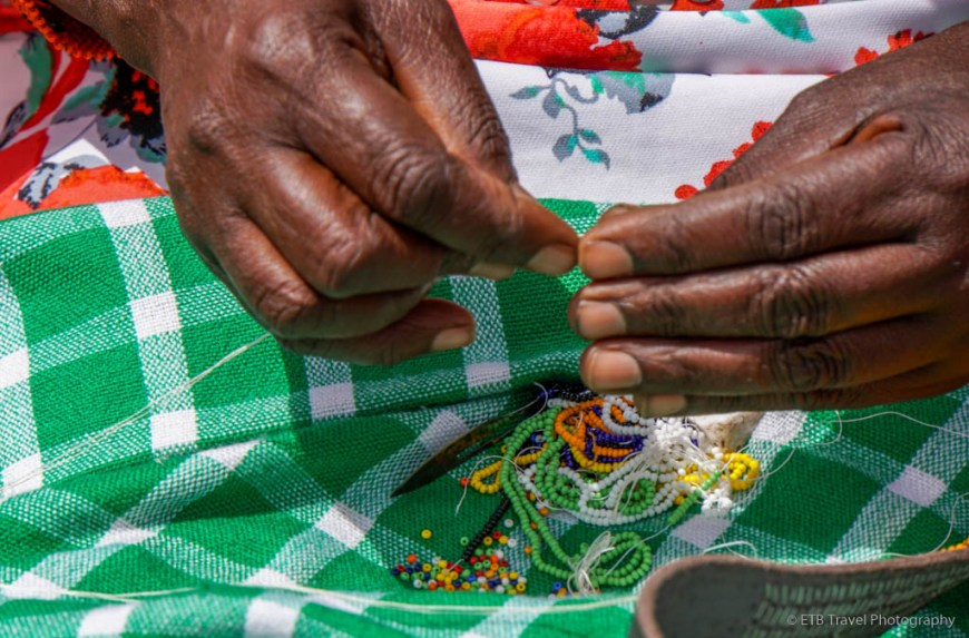 hands of a beading lady