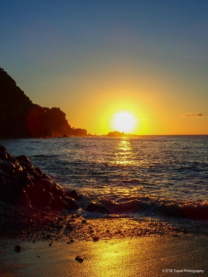 Last sunset on earth in cape Taputapu on American Samoa